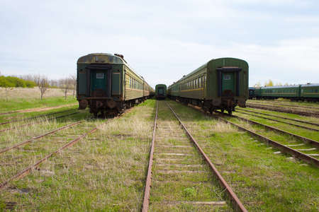 Old Abandoned train carriages in a decaying depot