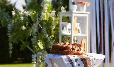 Wedding. Wedding ceremony. Vintage decorative details with white flowers in the wedding ceremony area Stok Fotoğraf