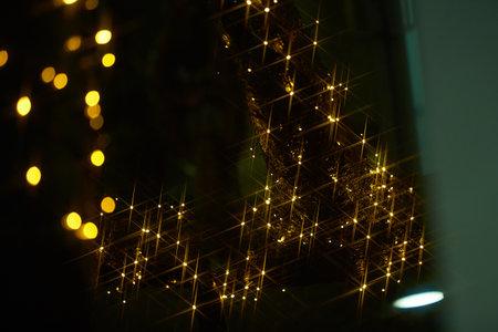 Holiday electric garlands yellow on dark background. city street Christmas decoration. Reklamní fotografie