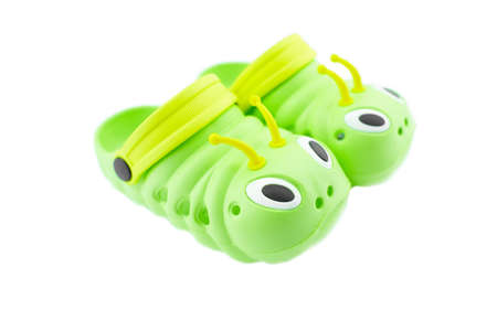 Pair of bright green children's clogs isolated on the white background. Foto de archivo