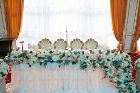 Beautifully decorated in blue green colors wedding table with flower decoration.