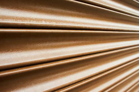 Roller door or roller shutter texture consist of roll formed steel in perspective view for background about industry, security, safety etc. Abstract background with perspective graphic line or texture