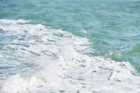 Texture of white wave in the ocean.