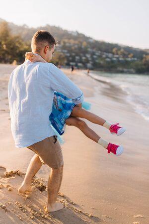 Father circling his daughter at sea on vacation