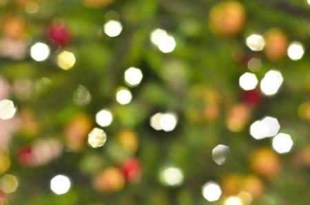 Illuminated Christmas tree on indistinct, blurred background. Christmas background. Фото со стока