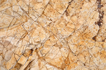 surface: Texture background, stone. Brown rock texture, closeup of pictures in a geological park.Rock texture, closeup of photo.