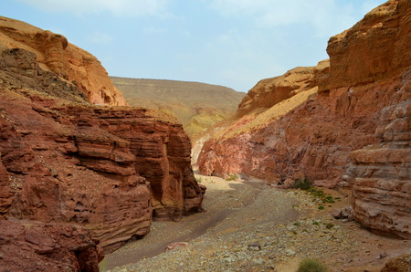 surface: Beautiful sandstone cliffs of the Red Canyon in the mountains of Southern Eilat, Israel.Beautiful sandstone cliffs of the Red Canyon in the mountains of Southern Eilat, Israel.