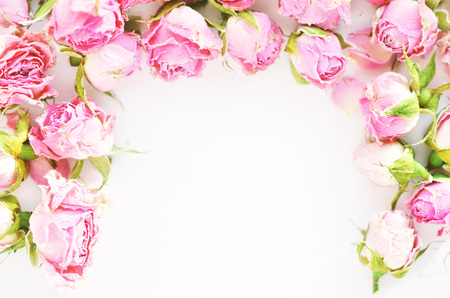 Flowers composition. Frame made of dried rose flowers on white  background. Stock Photo