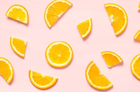 Fruit pattern of fresh orange slices on pastel background. Top view. - Image