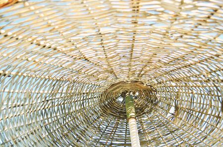 Close up of a straw parasol. Summer conсept. - Image