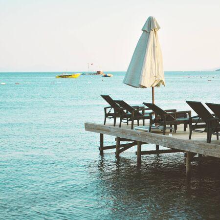 Beach Chairs on beautiful island, evening. - Image