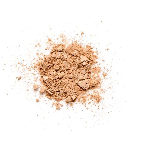 Beige abgestürztes Gesichtspuder für Make-up als Probe eines kosmetischen Produkts, isoliert auf weißem Hintergrund - Image Standard-Bild