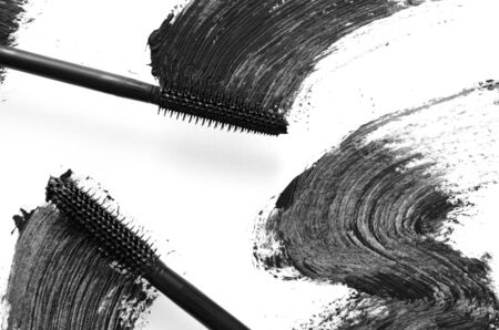 Stroke of black mascara with applicator brush close-up, isolated on white background. - Image