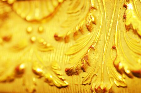 Close up of old baguette of the painting, gold carved leaves. - Image