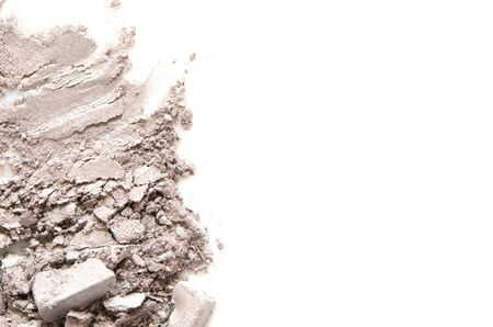 Eyeshadow cosmetic powder scattered. The concept of fashion and beauty industry. Close-up. - Image