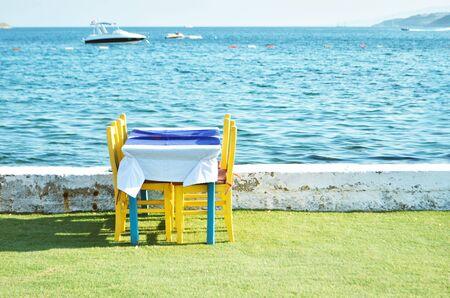 Beachfront restaurant. Holiday season. - Image