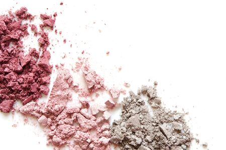 Crushed eyeshadow makeup set isolated on white background. The concept of fashion and beauty industry. Close-up. -