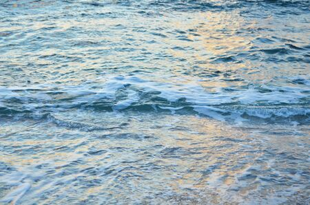 Sparkling water surface on sunset.  Nature background concept. - Image Stock Photo