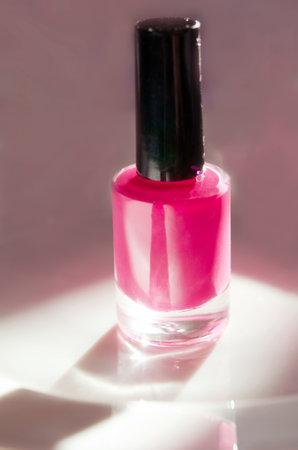 Pink nail polish. Natural hard light, deep shadows. The concept of fashion and beauty industry. - Image