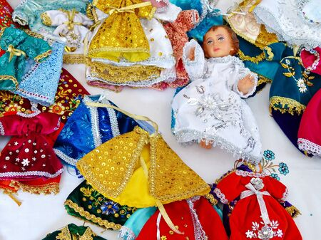 Dresses for The Infant Jesus used for celebrate tradition parad Pase del Ni?±o Viajero (the Passing of the Child Traveler) which holds on Christmas in city of Cuenca