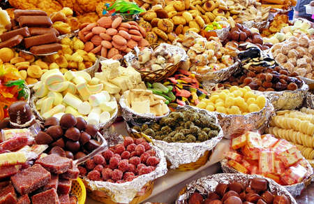 Traditional sweets: cookies, jelly, candy, chocolate, marshmallow, nuts and more at open market during catholic Corpus Christi celebration in Ecuador in Cuenca Banco de Imagens
