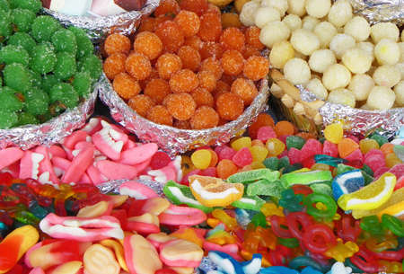 Traditional sweets: cookies, jelly, candy, chocolate, marshmallow, nuts and more during catholic Corpus Christi celebration in numerous stands at open market in Cuenca, Ecuador Banco de Imagens