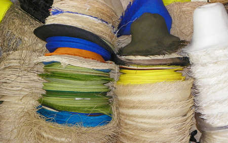 Authentic Panama hats or Paja Toquilla Hats, weaving from straw, unfinished, at paja toquilla factory, Cuenca, Ecuador