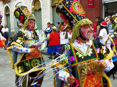 Cuenca, Ecuador - December 24, 2016: Christmas parade Pase del Nino Viajero (Traveling Child) in honor of baby Jesus. Folklor personage of Ecuador