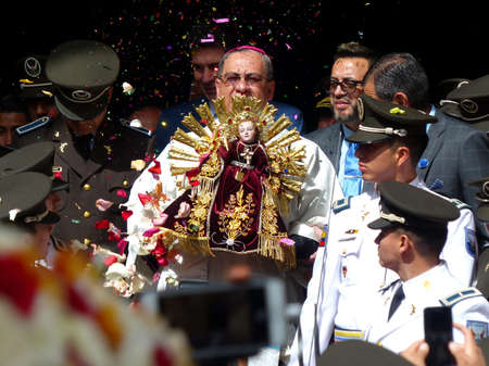 Cuenca, Ecuador-December 24,2019:Parade 'Pase Del Niño Viajero' (Traveling Child) is celebrated in honor of baby Jesus in Cuenca. Bishop carries the sculpture of the infant Jesus called Niño Viajero