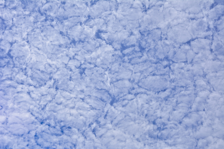 Background of high clouds against the blue sky. High clouds on a clear summer day.