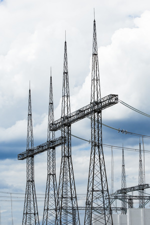 Electric power transmission lines. High voltage switchgear and equipment in front of power plant. Stock Photo