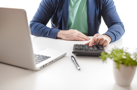 Closeup of a man checking accounts.  Stock market chart and finger pointing on tablet in office. Copy paste Stock Photo