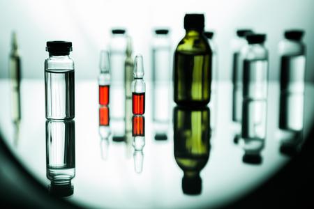 Group object of liquid medicinal agent in limpid glassware in medical laboratory Foto de archivo