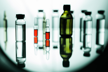Group object of liquid medicinal agent in limpid glassware in medical laboratory Archivio Fotografico