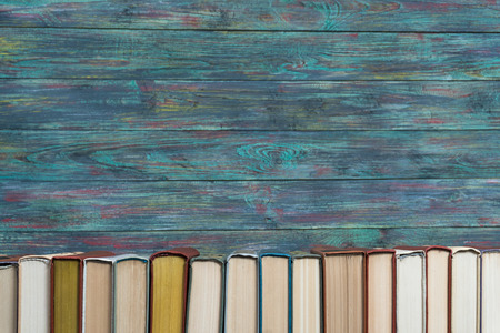 Stack books on wooden background. Back to school with copy space. Stockfoto