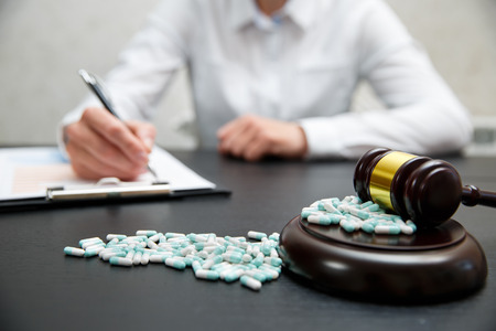 Medicine law concept. Judges gavel with pills close up 스톡 콘텐츠