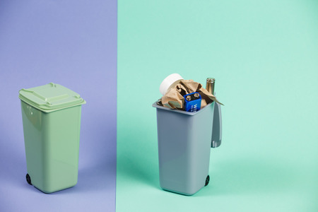 Recycling. Materials for recycle and reuse on pastel background. Ecology concept, a lot of recyclable objects in containers Reklamní fotografie