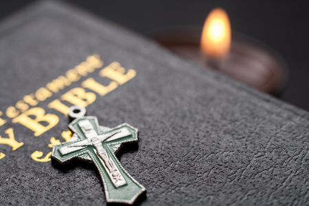 The Bible Opened. The holy bible close up and the cross 版權商用圖片