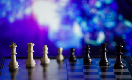 Chess background central figure. Chess strategy concept is on the bright background. Abstract background of business concept . Selective focus shallow depth field.
