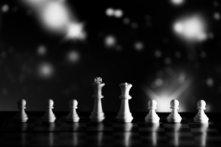 Chess background central figure. Chess strategy concept is on the bright background. Abstract background of business concept . Selective focus shallow depth field. Black and white image.