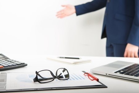 businessman working alone in the office. Cropped image of male accountant working with papers