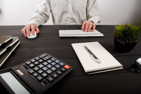 Close up of man accountant or banker making calculations.