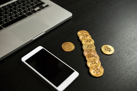 Bitcoin coin symbol on laptop future concept financial currency crypto currency sign. With copy space