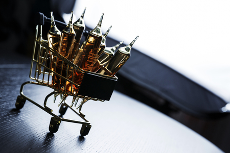 Many brown ampoules set in shopping cart Stock Photo