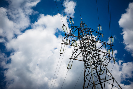 Electricity is the major energy of the world. High voltage post. High voltage tower sky background. Aerial industrial background group of transmission towers.