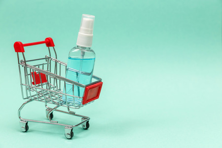 Medicines in shopping cart on blue background. The concept: trade in medicines, pharmacies. Copy spase, spase for text. Stok Fotoğraf