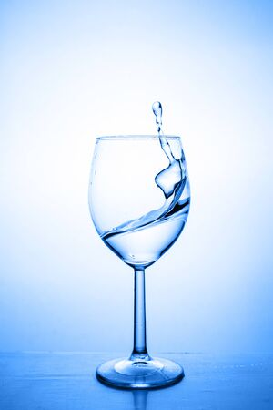 Glass with water up and splash. healthy lifestyle concept