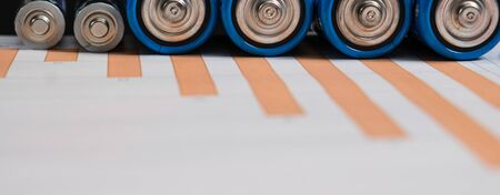 Energy concept. Ordinary battery on paper surface with business chart 스톡 콘텐츠 - 131821944