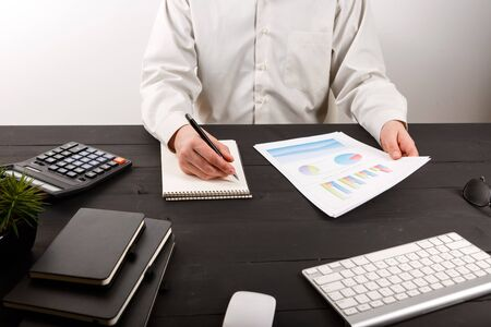 Close up of man accountant or banker making calculations. Close up of man accountant or banker making calculations. Savings, finances and economy concept