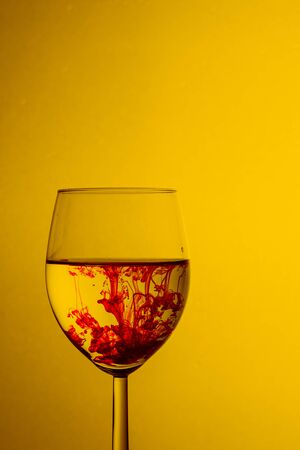 Paint swirling in water. Splashes of paint in a glass